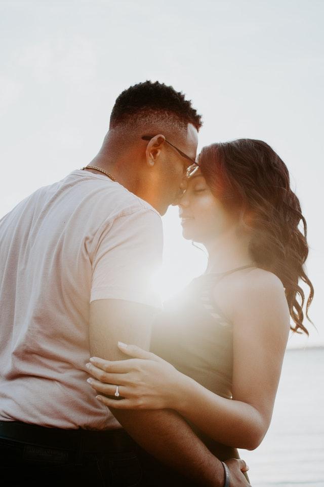 Kissing couple, happy couple, engaged planning celebrations